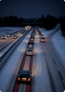 Snow-covered highway during rush-hour